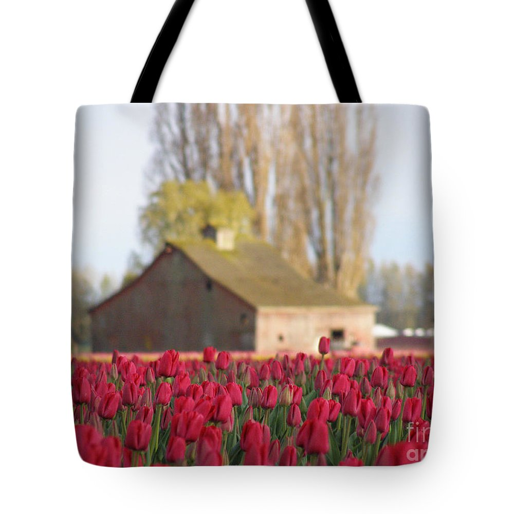 Tulip Tote Bag featuring the photograph Red by Louise Magno