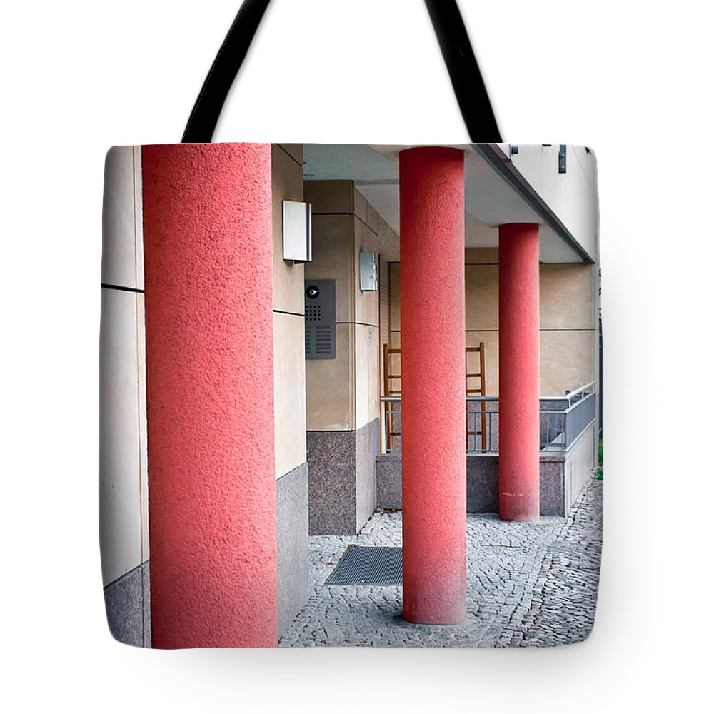 Abstract Tote Bag featuring the photograph Red Pillars by Tom Gowanlock