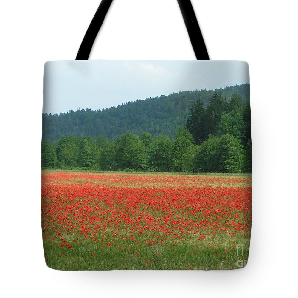 Poppies Tote Bag featuring the photograph Red Poppies by Karen Granado