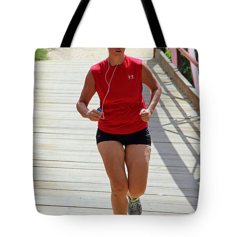 Red Tote Bag featuring the photograph Red Runner by Cora Wandel