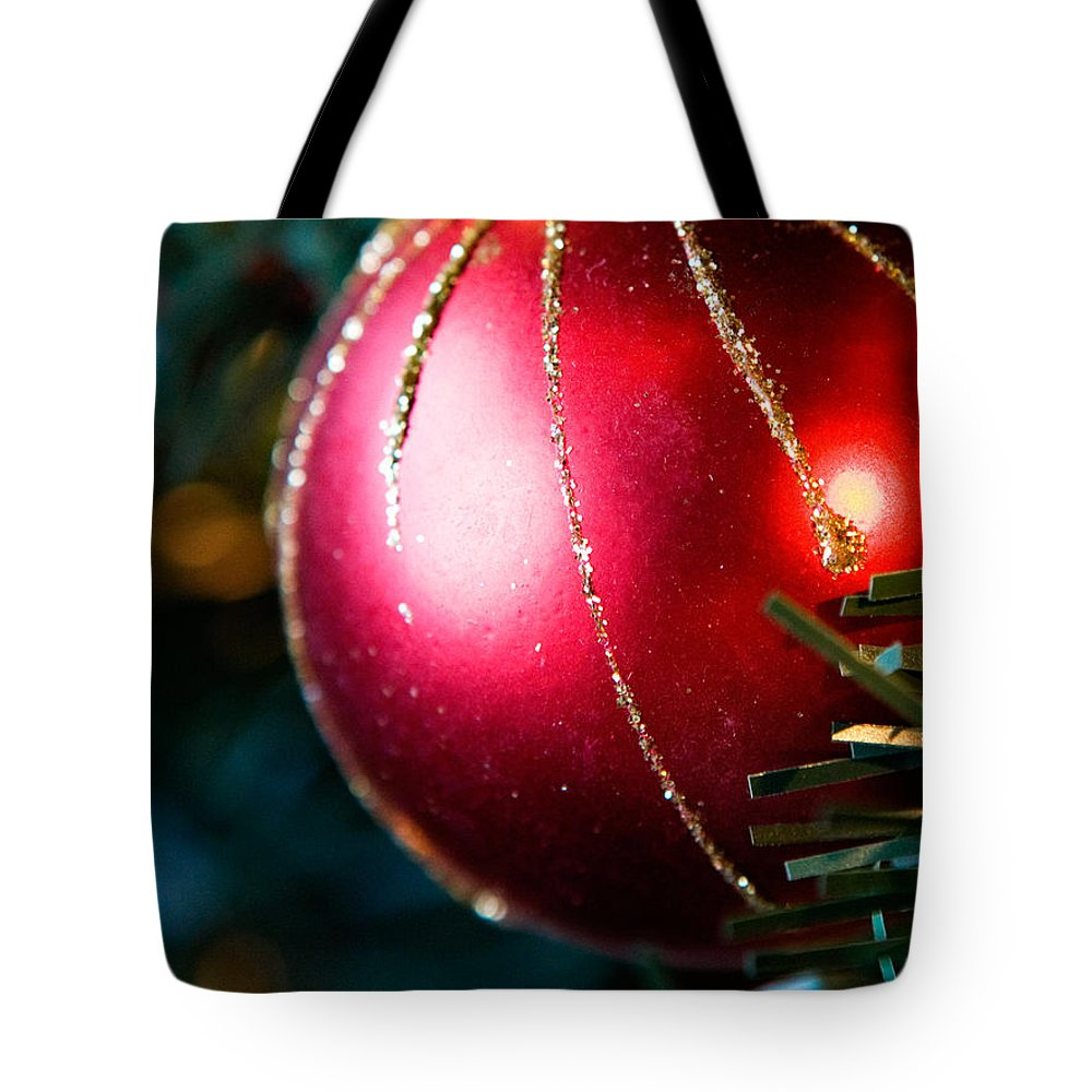Red Tote Bag featuring the photograph Red Shiny Ornament by Marilyn Hunt