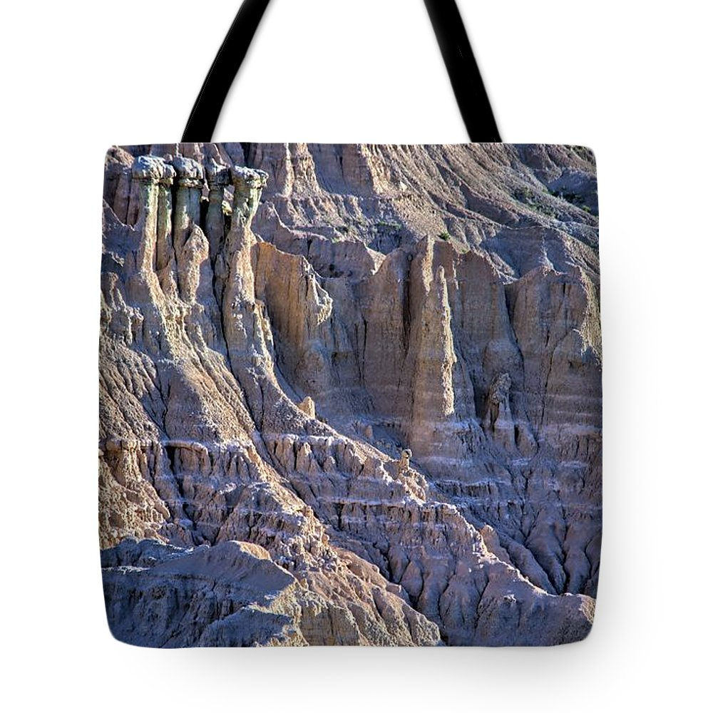 Badlands Tote Bag featuring the photograph Red Shirt Formation 2 by Bonfire Photography