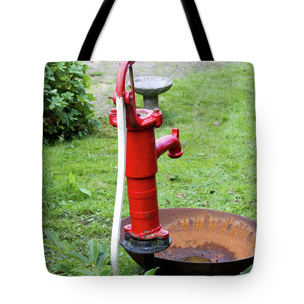 Bright Tote Bag featuring the photograph Red Water Pump by Bernard Barcos