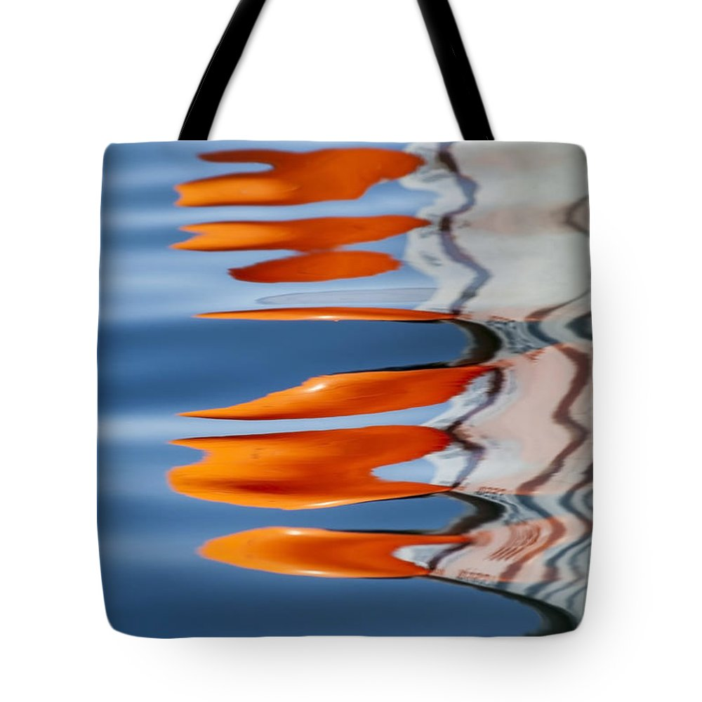 Reflection Tote Bag featuring the photograph Water Reflection Of Orange Blobs And Black Zig Zagging Lines by Sharon Foelz