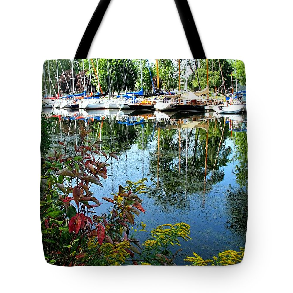 Flowers Tote Bag featuring the photograph Reflections In The Pool by Ian MacDonald