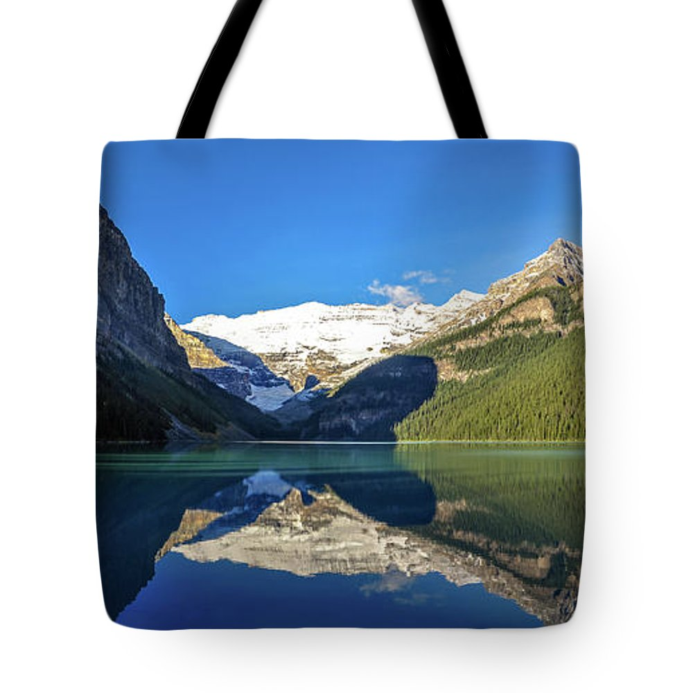 Alberta Tote Bag featuring the photograph Reflections In The Water At Lake Louise, Canada by Daniela Constantinescu
