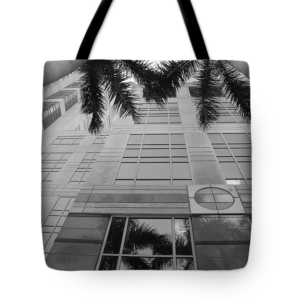Architecture Tote Bag featuring the photograph Reflections On The Building by Rob Hans
