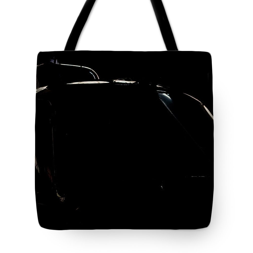 Airbus B3 Tote Bag featuring the photograph Reflective Helicopter Outline by Paul Job