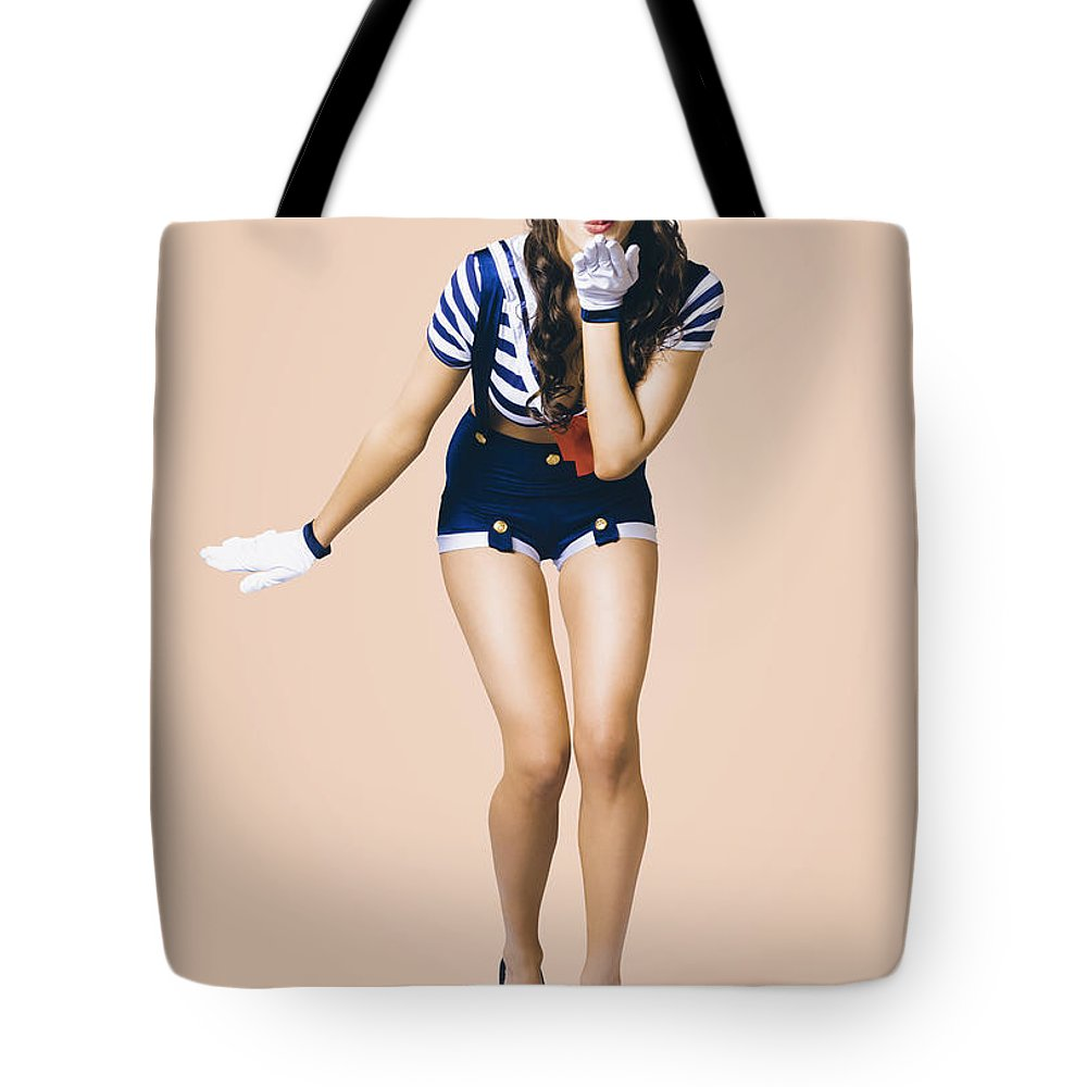 Girl Tote Bag featuring the photograph Retro Pinup Girl Blowing Travelling Departure Kiss by Jorgo Photography - Wall Art Gallery