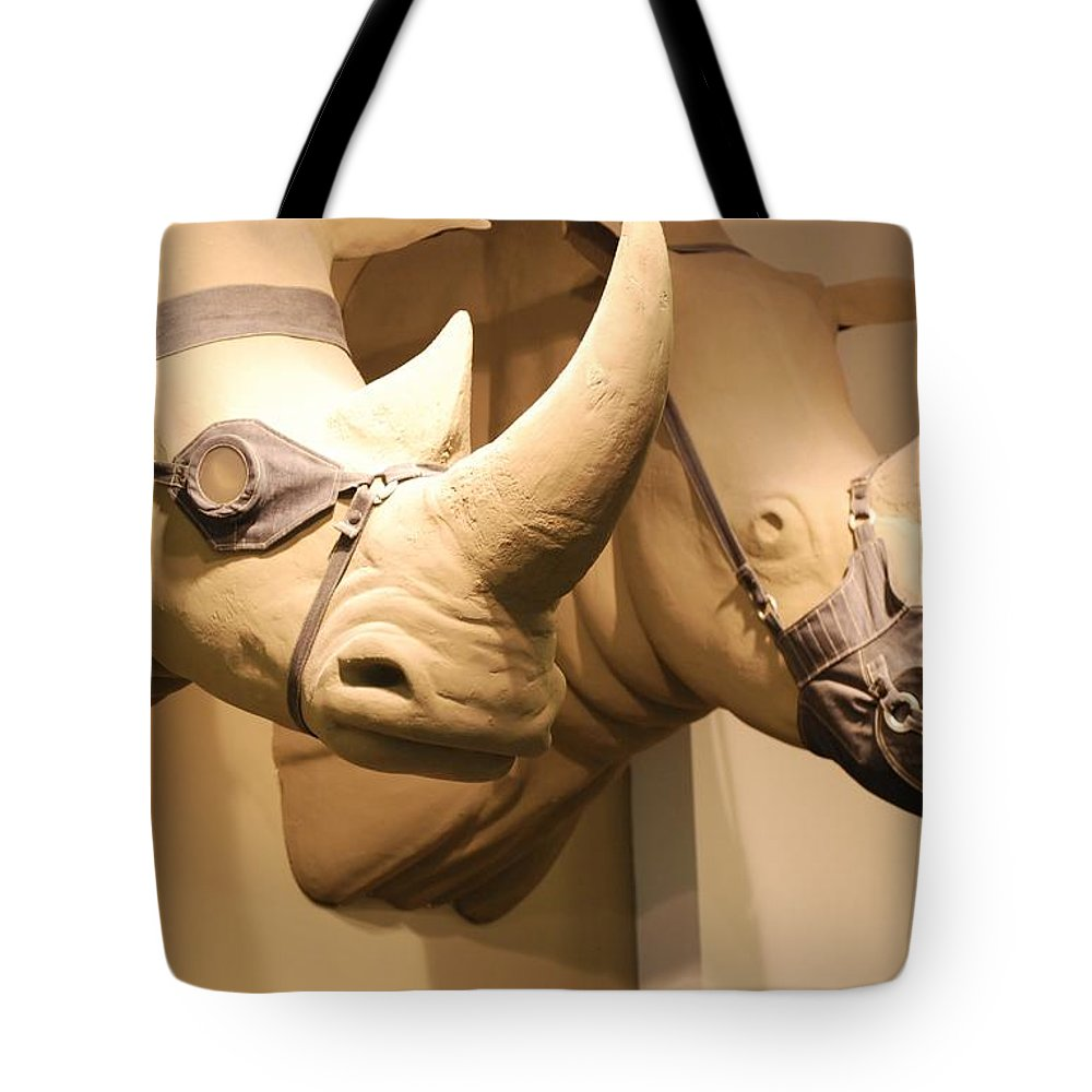 Macro Tote Bag featuring the photograph Rhinos by Rob Hans