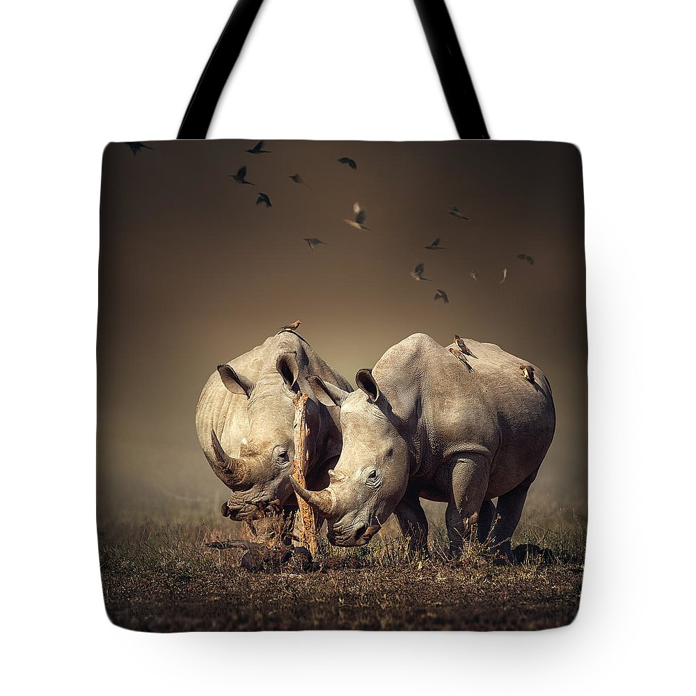 Rhinoceros Tote Bag featuring the photograph Rhino's With Birds by Johan Swanepoel