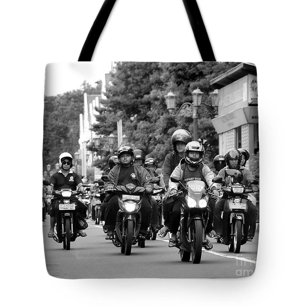 Riders Tote Bag featuring the photograph Riders by Charuhas Images
