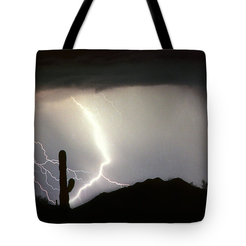 Lightning Tote Bag featuring the photograph Ridin The Southwest Desert Storm Out by James BO Insogna