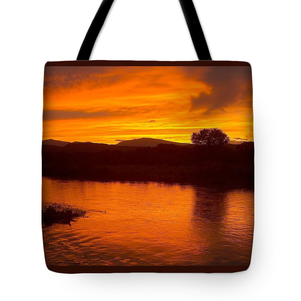Sunset Tote Bag featuring the photograph Rio Grande Sunset by Tim McCarthy