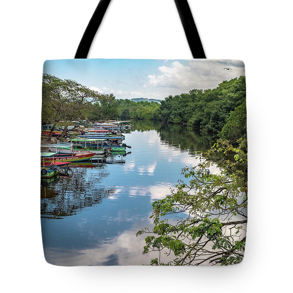 Negril Tote Bag featuring the photograph River Boats Docked by Debbie Ann Powell