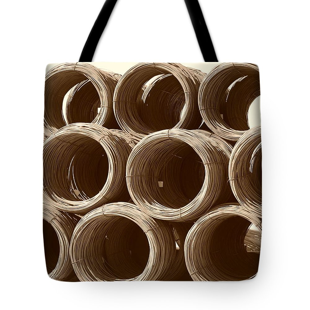 Metal Tote Bag featuring the photograph Rolled Steele by Rob Hans