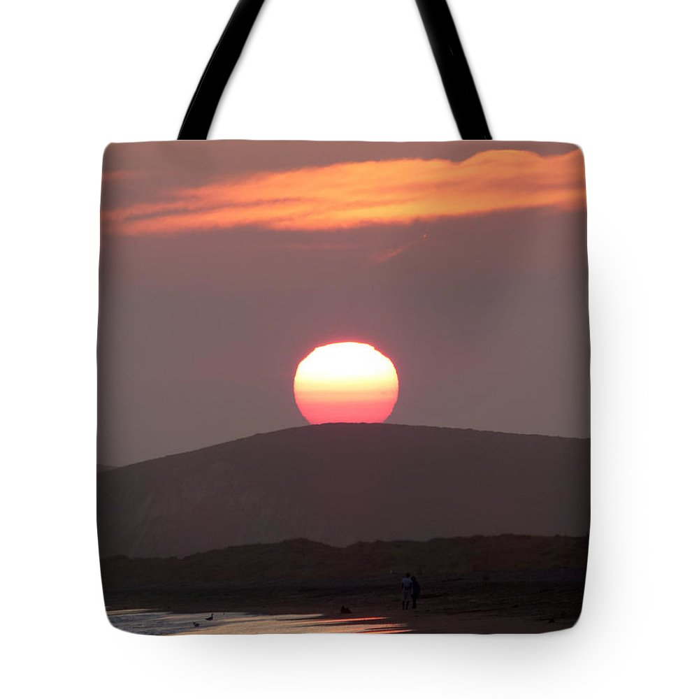Sunset Tote Bag featuring the photograph The Sun As A Chinese Lantern by Andrea Freeman