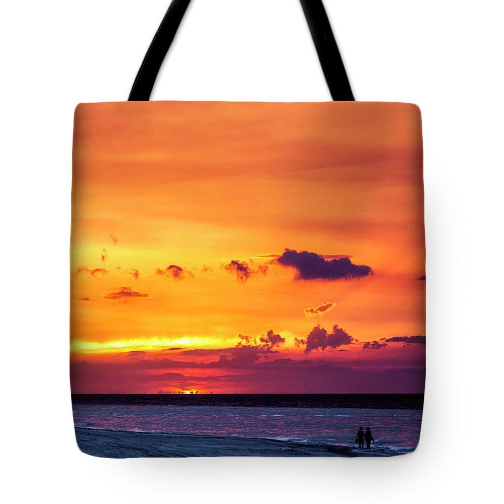 Romantic Sunset At The Cuban Beach; Cuban; Cuba; Sunset; Beach; Couple; Beach; Sand; Sea; Seaside; Shore; Clouds; Sun; Romance; Romantic; Colourful; Hope; Faith; Love; Happiness; Photography & Digital Art; Photography; Photo; Photo Art; Art; Digital Art; 2bhappy4ever; 2bhappy4ever.com; 2bhappy4evercom; Tobehappyforever; Tote Bag featuring the photograph Romantic Sunset at the Cuban Beach by Erron