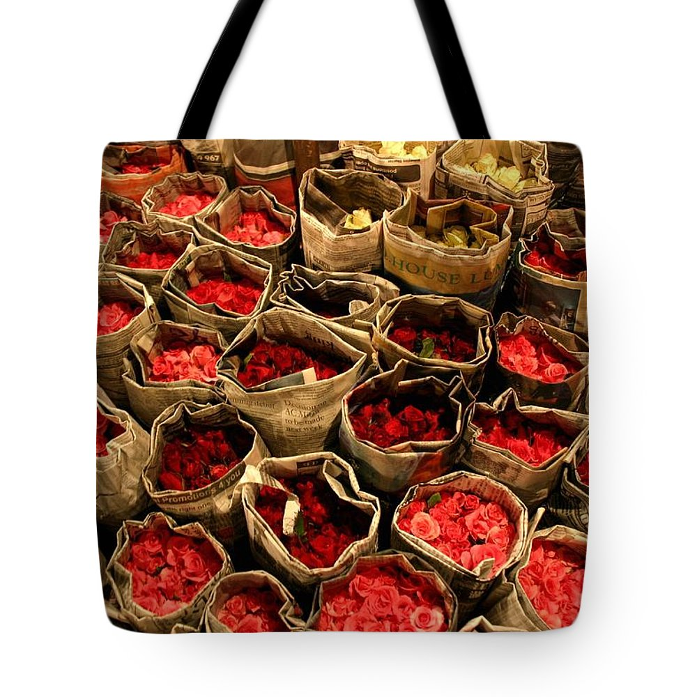 Roses Tote Bag featuring the photograph Rose Rolled In Newspaper by Minaz Jantz