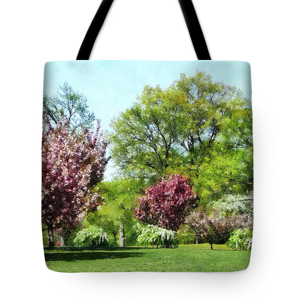 Spring Tote Bag featuring the photograph Row Of Flowering Trees by Susan Savad