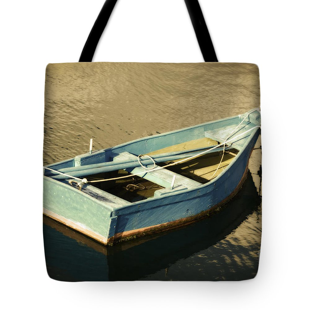 Blue Rowboat At Twilight Tote Bag featuring the photograph Rowboat At Twilight by Mary Machare