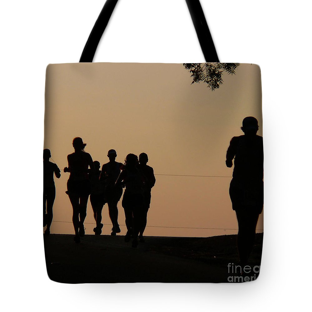 Running Tote Bag featuring the photograph Running by Angela Wright