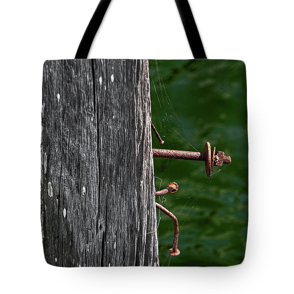 Bolt Tote Bag featuring the photograph Rusted by Christopher Holmes