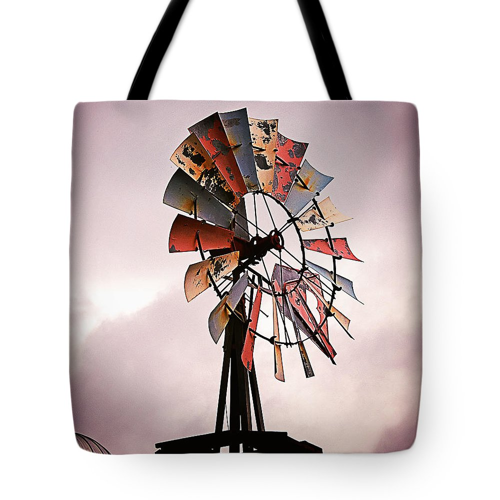 Weathered Tote Bag featuring the photograph Rustic Windmill by Laura Gordon