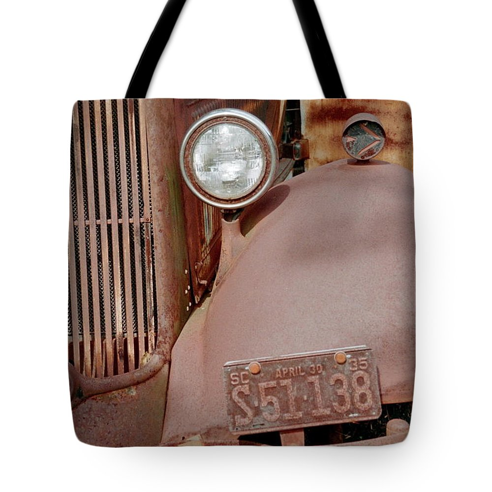 Car Tote Bag featuring the photograph Rusty by Flavia Westerwelle