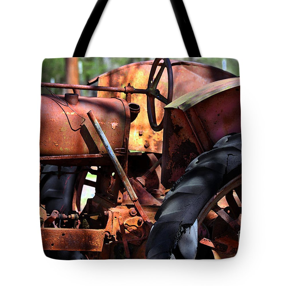 Tractor Tote Bag featuring the photograph Rusty Tractor by Catherine Sherman