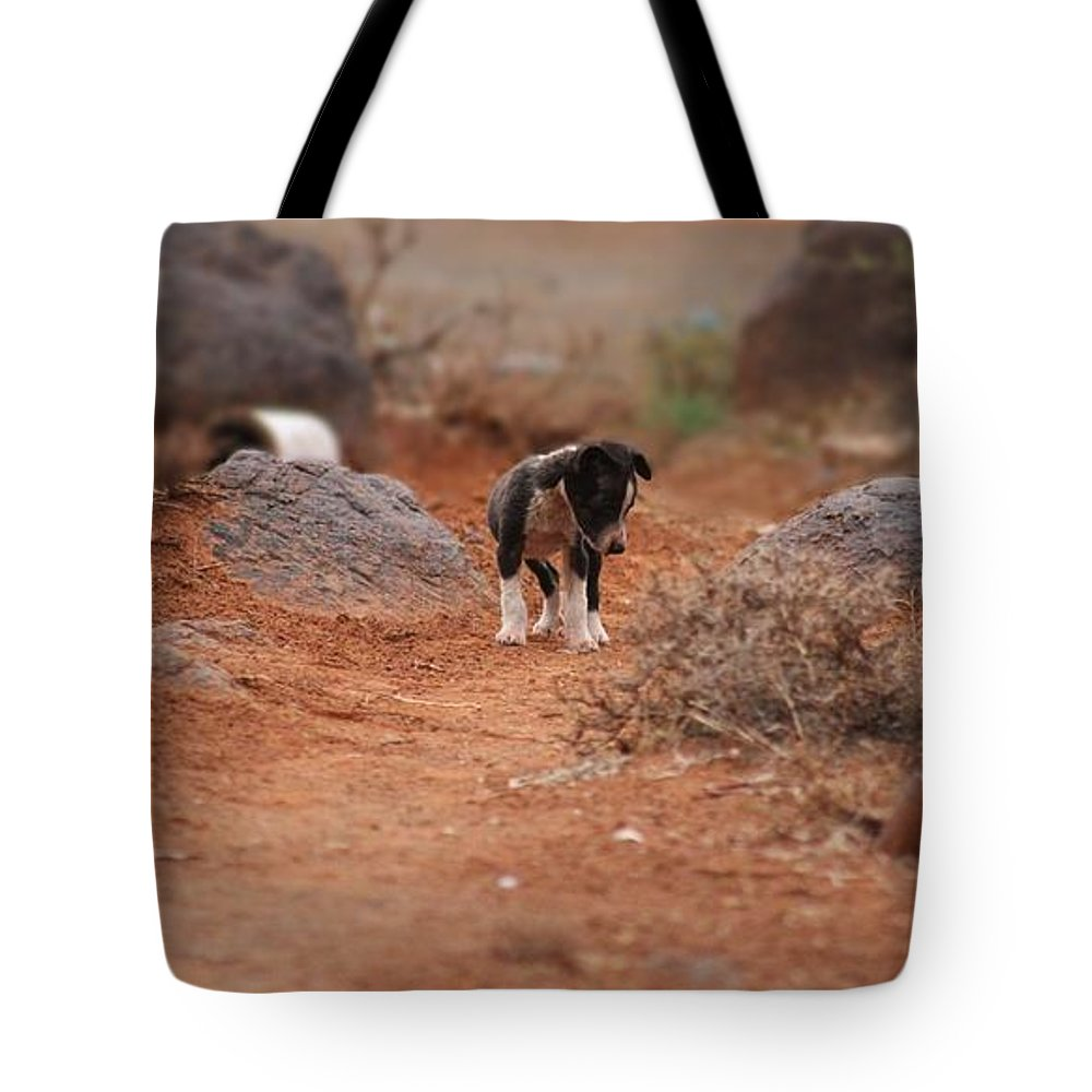 Puppy Tote Bag featuring the photograph Sad To See Me Leave by Elton Oliver