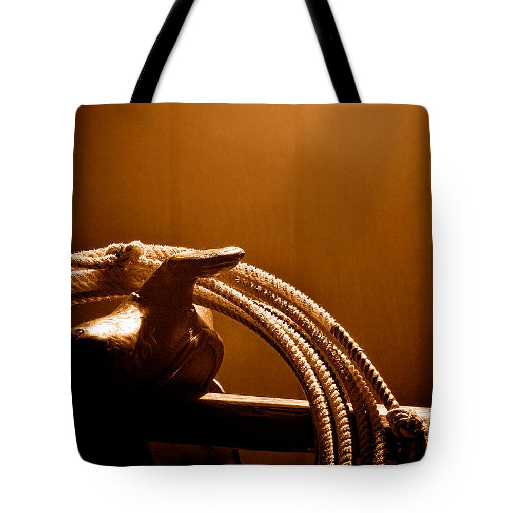 Cowboy Tote Bag featuring the photograph Saddle In A Barn - Sepia by Olivier Le Queinec