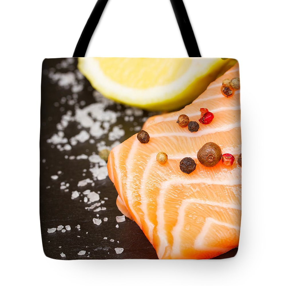 Salmon Tote Bag featuring the photograph Salmon Steak And Spices by Anastasy Yarmolovich