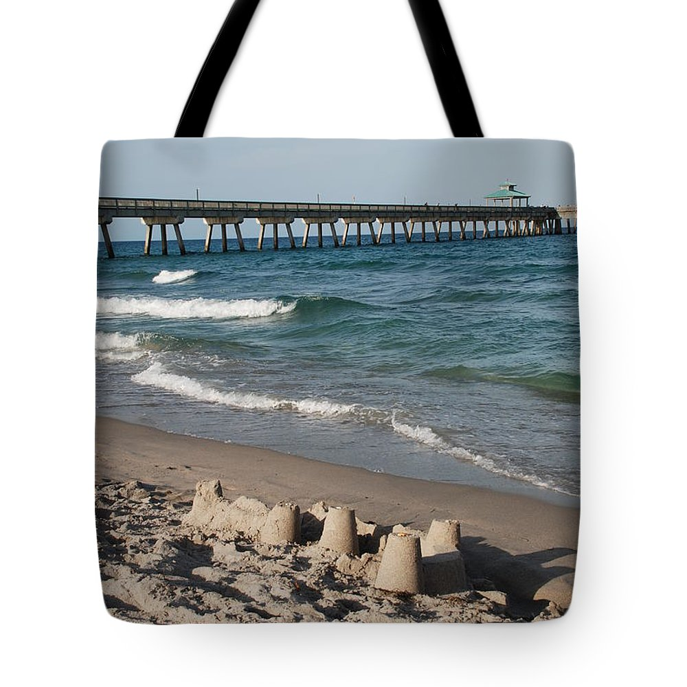 Sea Scape Tote Bag featuring the photograph Sand Castles And Piers by Rob Hans