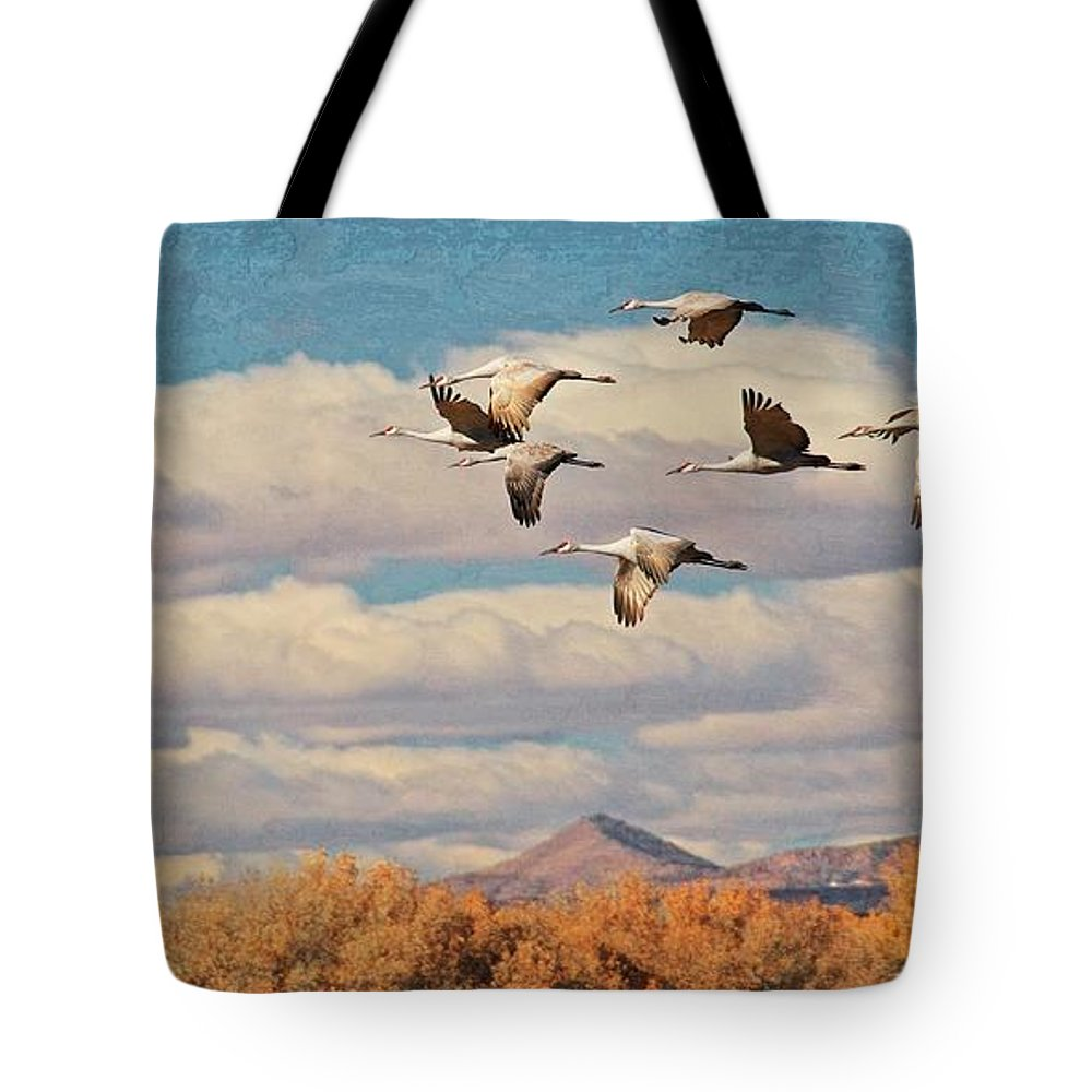Nature Tote Bag featuring the photograph Sandhill Cranes over Bosque del Apache Wildlife Refuge, New Mexico by Zayne Diamond Photographic