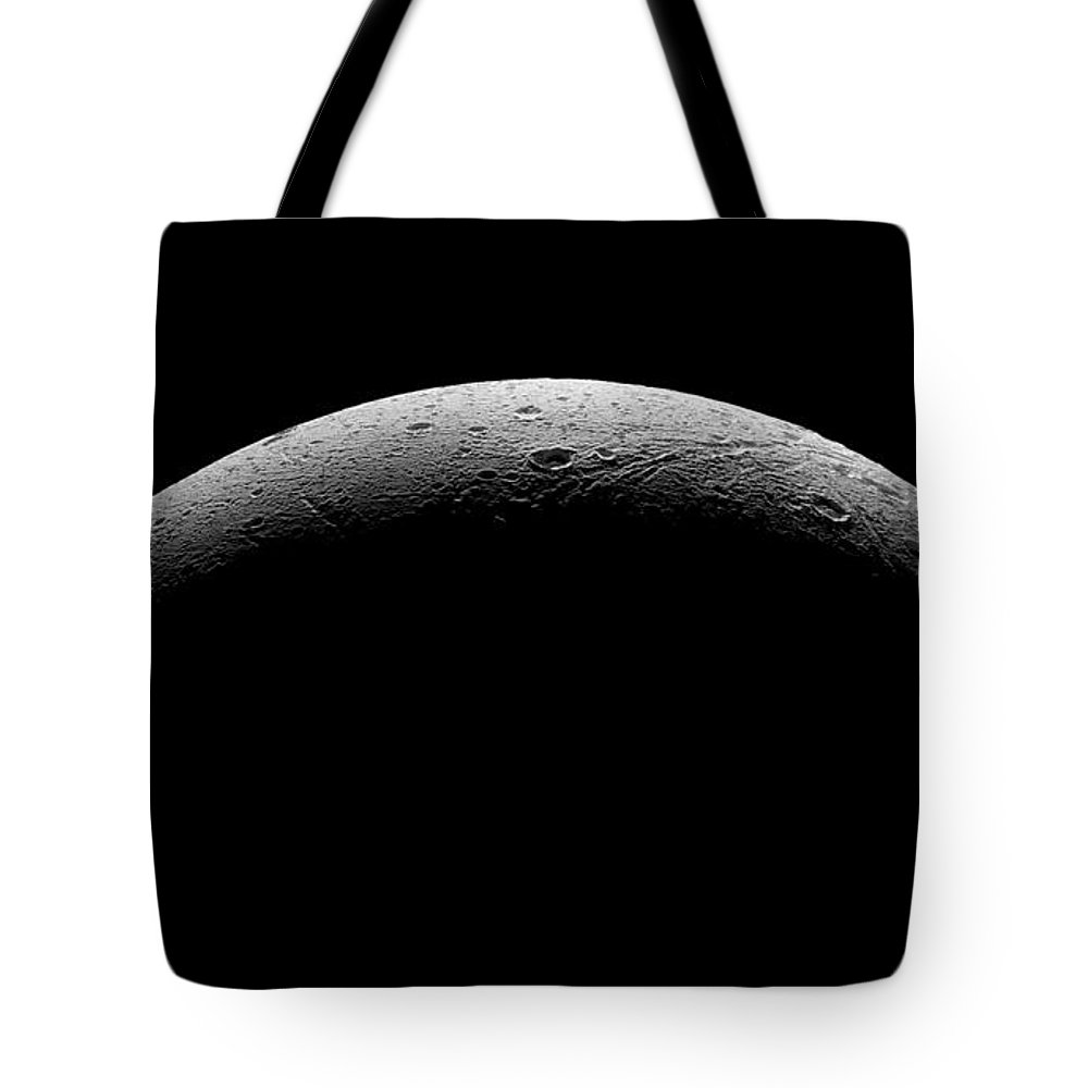 Astronomical Tote Bag featuring the photograph Saturn's Moon Dione by Nasa