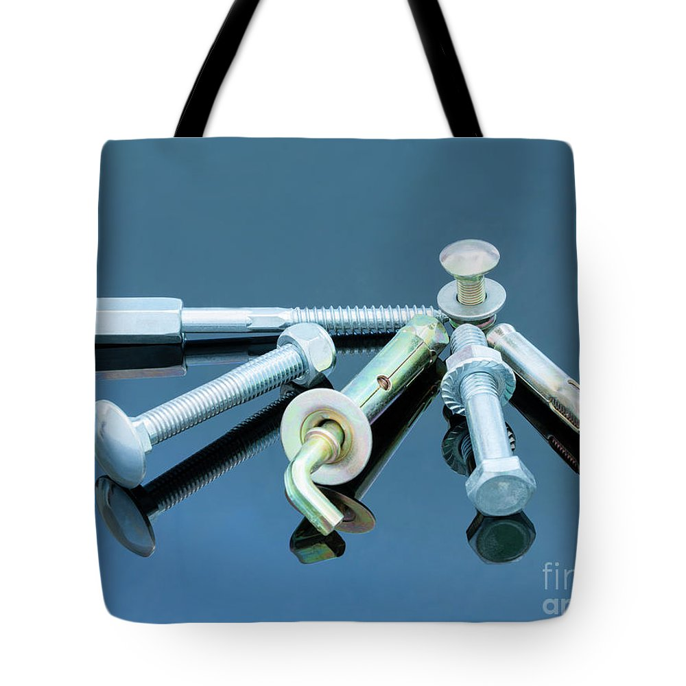 Metal Tote Bag featuring the photograph Screwbolts Screw Nuts, Hanger And Bolt Washers On Blue Background Construction Concept. by Sergii Petruk