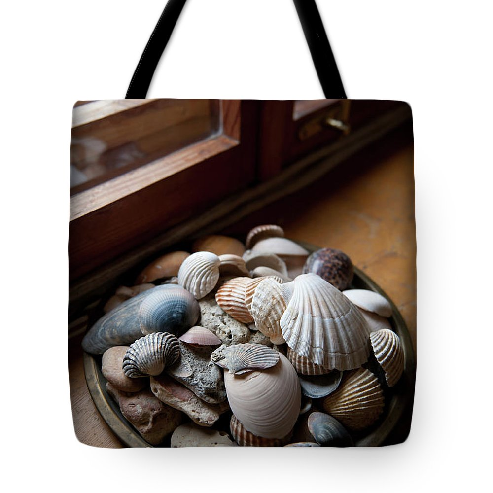 Shell Tote Bag featuring the photograph Sea Shells And Stones On Windowsill by Arletta Cwalina