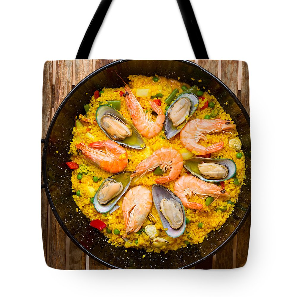 Paella Tote Bag featuring the photograph Seafood Paella by Anastasy Yarmolovich
