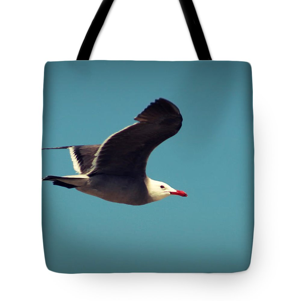 Bird Tote Bag featuring the photograph Seagull Aflight by Charles Benavidez