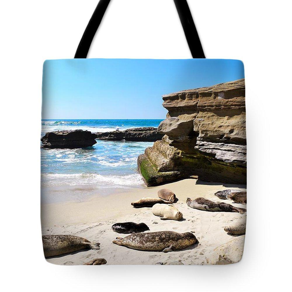 Hao Aiken Tote Bag featuring the photograph Seals Siesta On La Jolla Beach by Hao Aiken