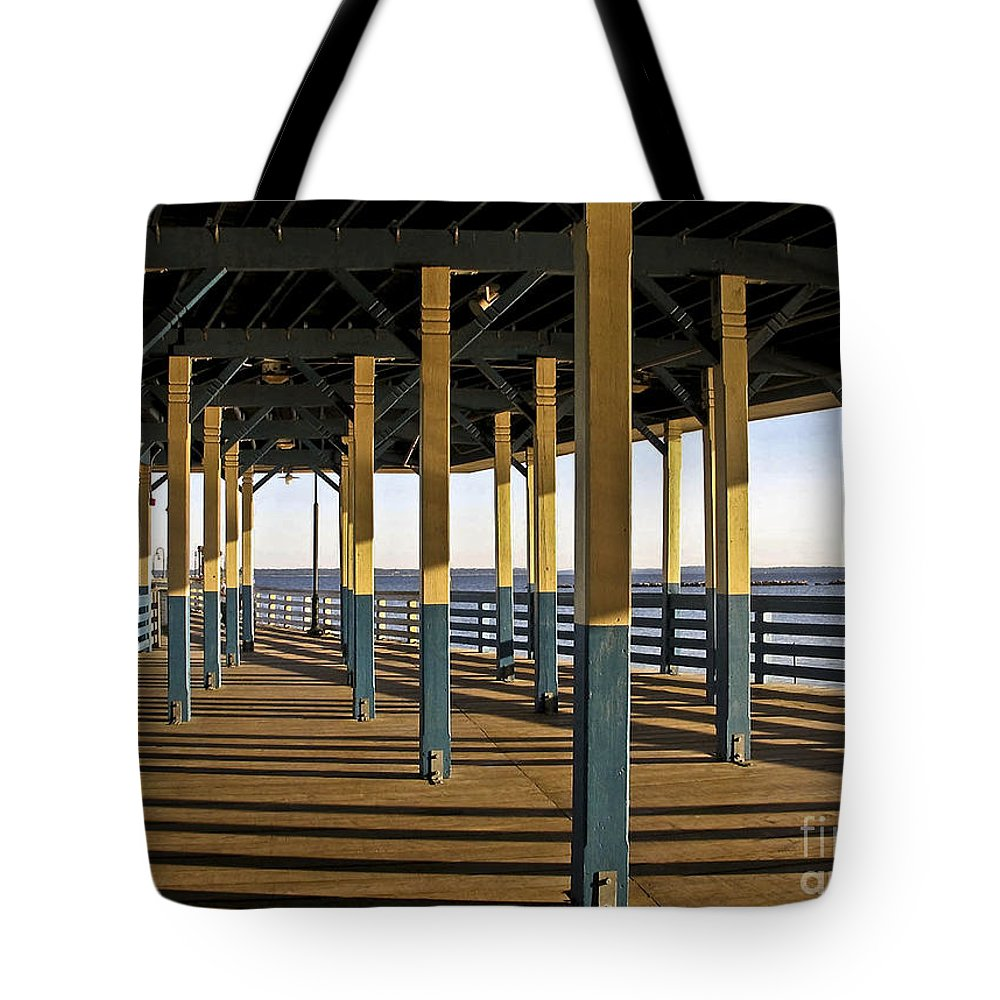 Seascape Tote Bag featuring the photograph Seascape Walk On The Pier by Carol F Austin
