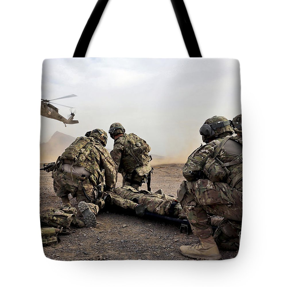 Afghanistan Tote Bag featuring the photograph Security Force Team Members Wait by Stocktrek Images