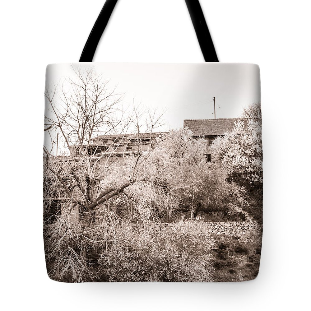 Cyprus Tote Bag featuring the photograph Sepia-toned Blooming Almond Trees Of Fikardou Village 1 by Iordanis Pallikaras