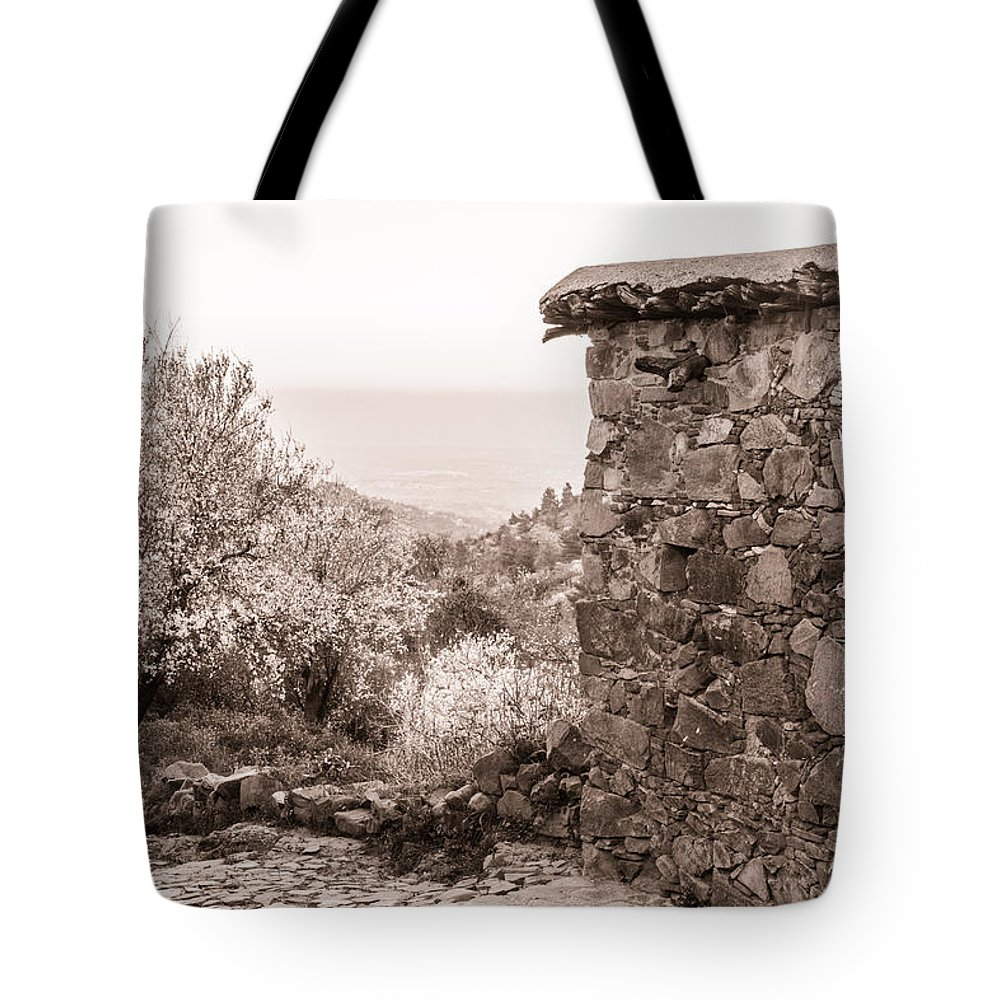 Cyprus Tote Bag featuring the photograph Sepia-toned Fikardou Village Scene 1 by Iordanis Pallikaras