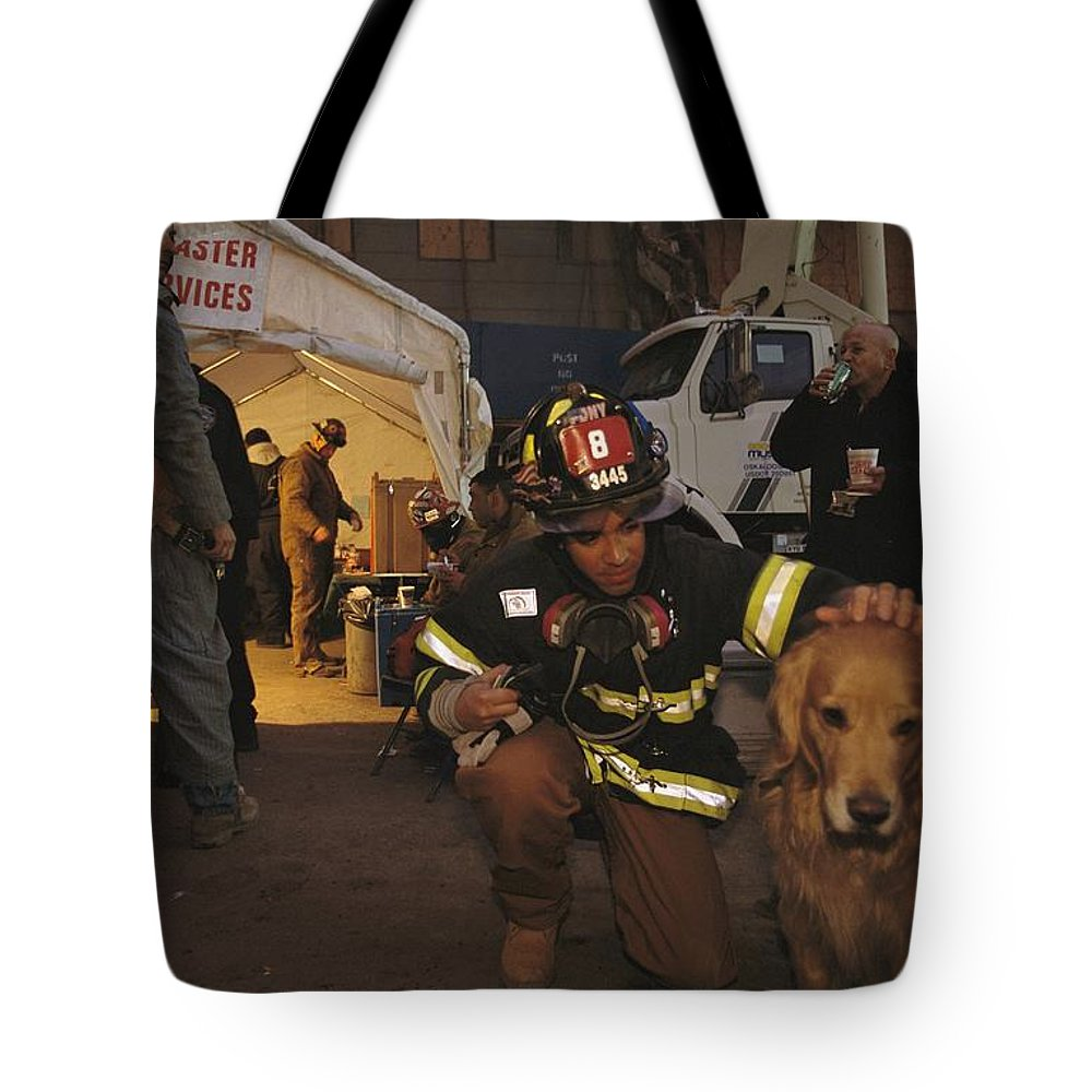 Animals Tote Bag featuring the photograph September 11th Rescue Workers Receive by Ira Block