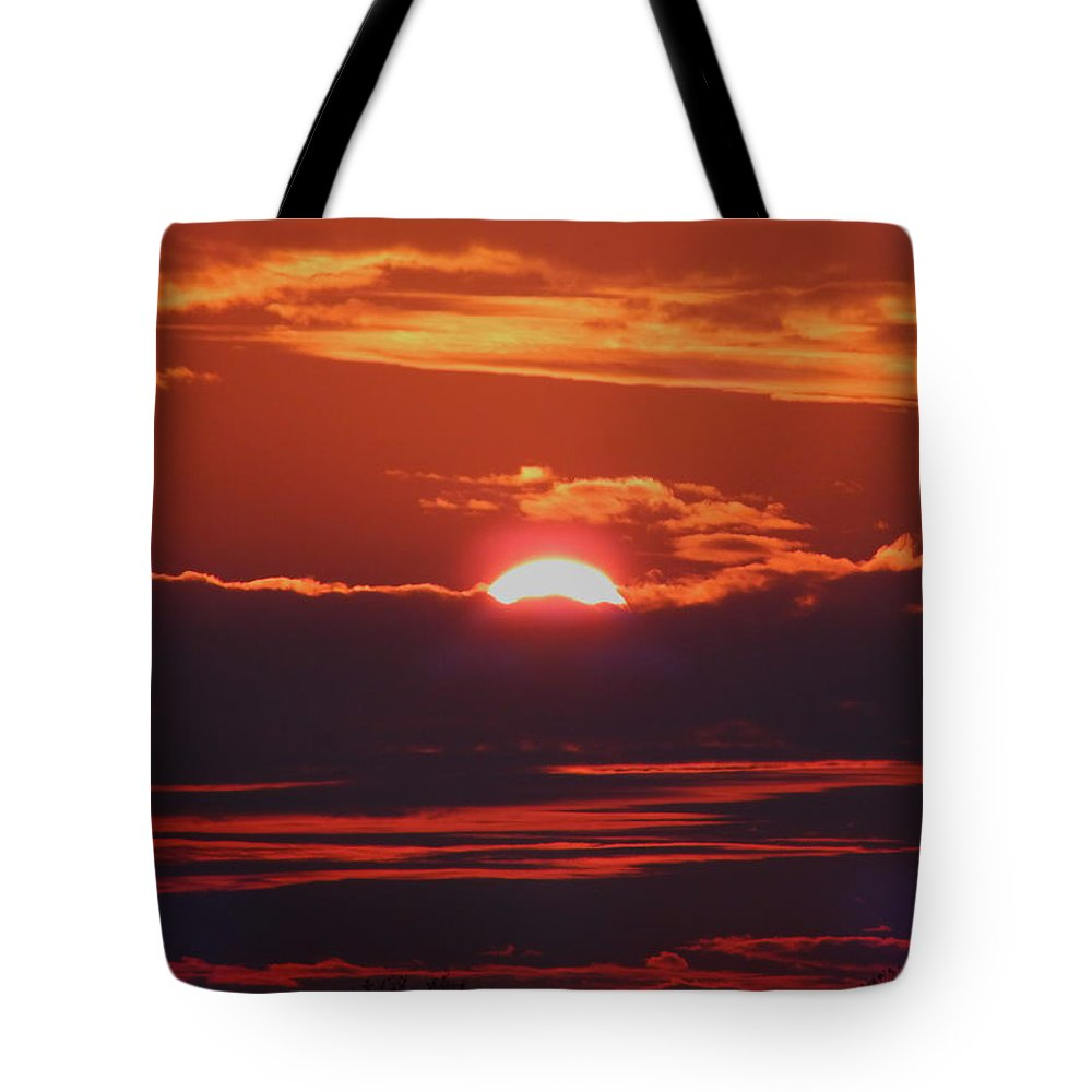 Sunset Tote Bag featuring the photograph Setting Sun by Gina Welch