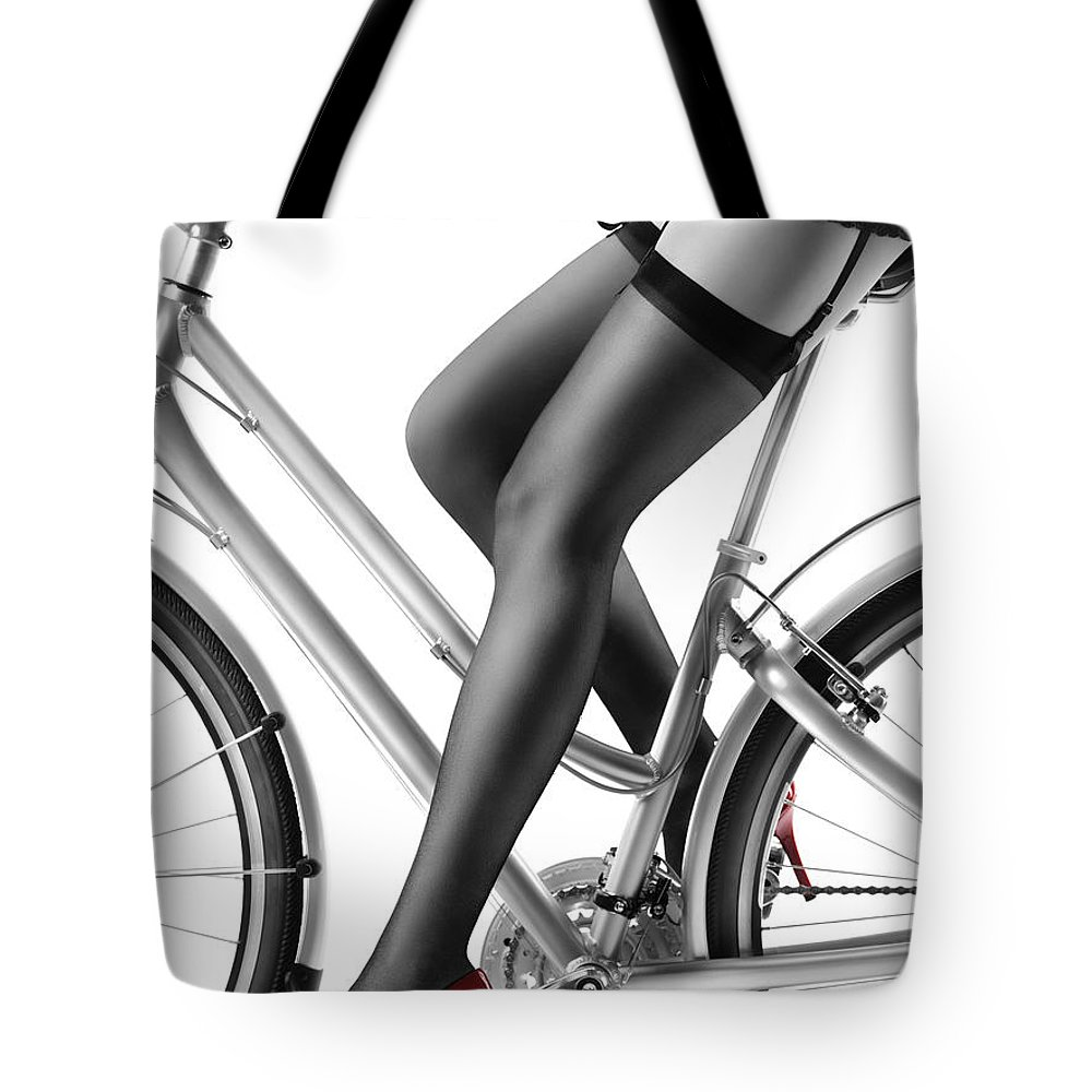 e011d78e006 Bicycle Tote Bag featuring the photograph Sexy Woman In Red High Heels And Stockings  Riding Bike