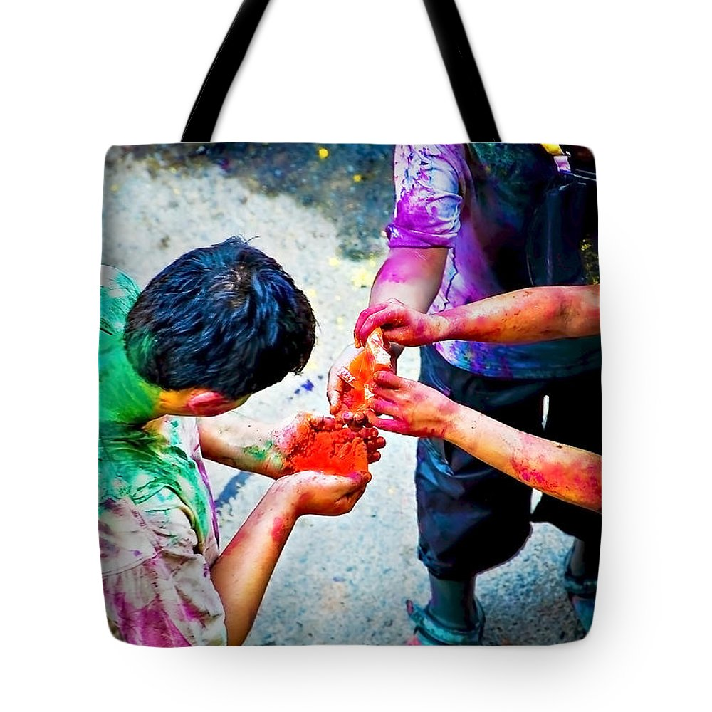 Historical Tote Bag featuring the photograph Sharing Colors Sharing Happiness by Charuhas Images