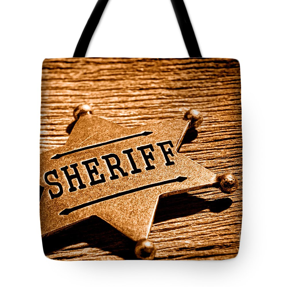 Sheriff Tote Bag featuring the photograph Sheriff Badge - Sepia by Olivier Le Queinec